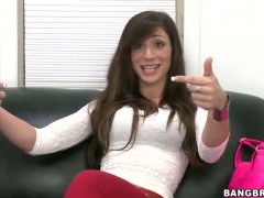 Dark haired Vanessa Sixxx does a hot interview on couch
